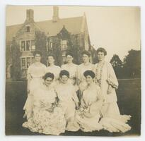 Students from the class of 1904 in white dresses